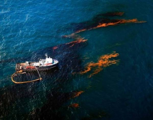 Boat skims oil from surface of Gulf water, which usually caught dead sea turtles and other marine creatures killed by the oil. NOAA